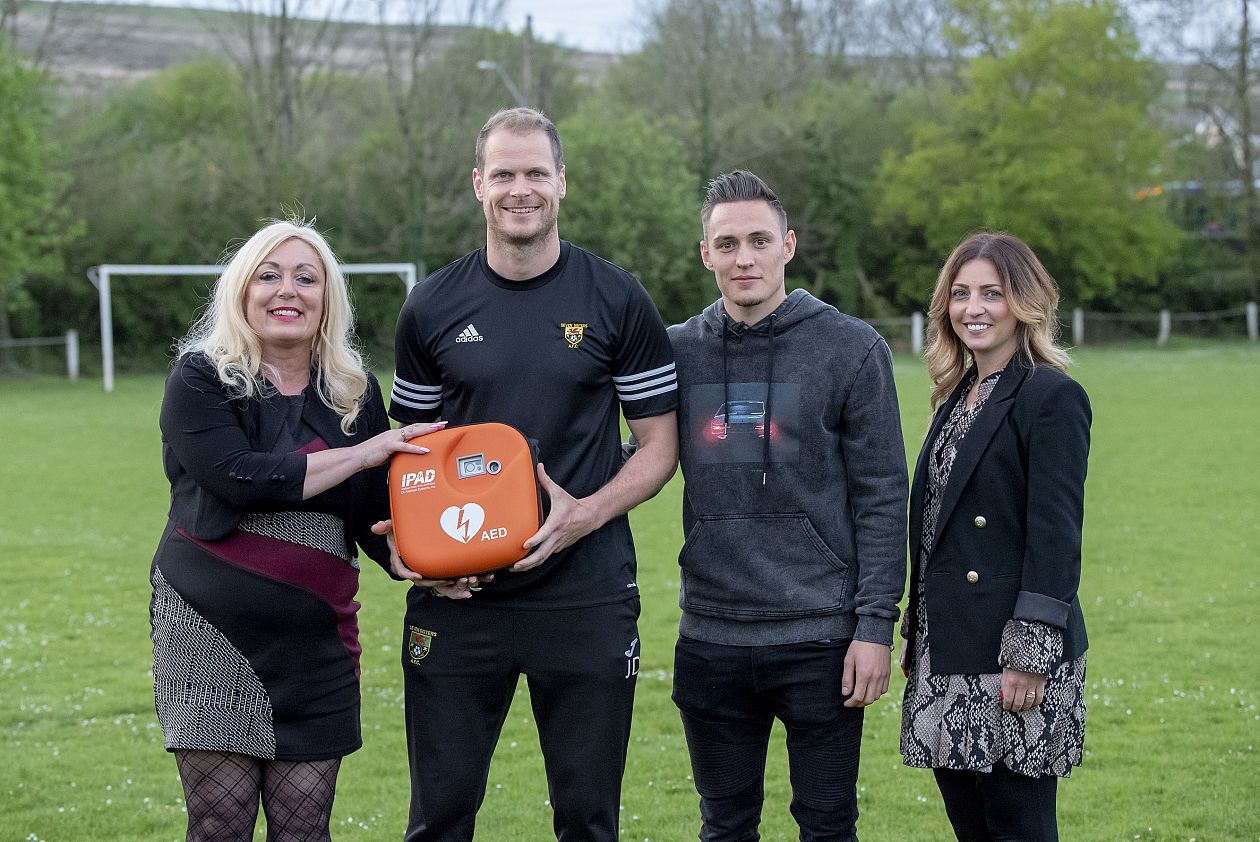 Connor Roberts delivers defib and training to local club